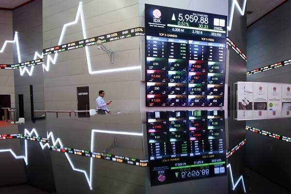 Dow Jones Tekor, Investor Sorot Keputusan The Fed